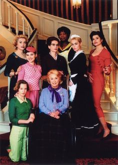Catherine Deneuve (far left), Virginie Ledoyen (left), Ludivine Sagnier (bottom left), Danielle Darrieux (bottom center), Isabelle Huppert (middle center), Firmine Richard (top center), Emmanuelle Béart (right), and Fanny Ardant (far right).  Title: 8 donne e un mistero