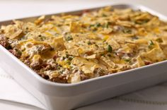 Tex-Mex Beef & Rice Casserole — Here's a ground beef and rice casserole recipe with all the Tex-Mex flavor they enjoy—onions and peppers, tortilla chips, cilantro, and a blend of creamy cheeses. Kraft Foods, Kraft Recipes, Mexican Food Recipes, Beef Recipes, Dinner Recipes, Cooking Recipes, What's Cooking, Cooking Cream, Recipies