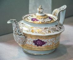 """Porcelain teapot painted in enamel colors and gold. Painted pattern no. """"2/66"""" In gold. From Coalport, Shropshire. 1820 1825. Norwich Castle Museum"""