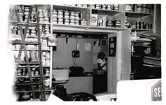 """ID#:0051 Date:1950s. Barbara Molyneaux in the paint department of Watson's Hardware. She and her husband, Glenn Ingersoll Molyneaux, Jr., """"Jim"""" owned the business from 1946 to 1988. Participant:Barbara Molyneaux. Additional Sources:O.H.I.O. Resource Center: Fred Maddock files., Historic Preservation Commission, Survey 1998, City Directories;Internet correspondence from Jim Molyneaux, 01/16/01. Interview with Jim and Barbara Molyneaux, 6/00. Interview with Glenn Molyneaux, 6/00"""