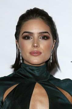 Olivia Culpo highlighted her toned and curvaceous figure in a skin tight emerald green gown, while posing for photos on the red carpet at the 2015 Miss Universe pageant held at The Axis at Planet Hollywood in Las Vegas, Nevada on December 20, 2015. The former Miss USA was appointed judge for the prestigious beauty pageant....