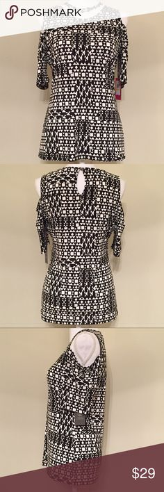 Vince Camuto Cold Shoulder Geometric Top Medium Vince Camuto Cold Shoulder Geometric Top Size Medium  * Brand: Vince Camuto * Size: Medium * Color: Black & White Geometric Print * Materials: 95% Polyester, 5% Spandex * Measurements taken laying flat & approximate: Chest 18 inches, Length 25 inches * Features: Cold Shoulder elbow length sleeves, keyhole back design * Condition: New with tags  *Smoke free home. Offers welcome.* Vince Camuto Tops