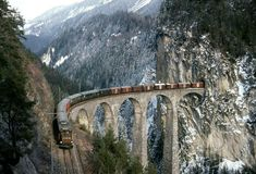 Bridge to landwasser(railway, taller 65 meters and 136 meters in length) - Switzerland By Train, Train Tracks, Train Rides, Train Route, Train Suisse, Old Steam Train, Bonde, Train Pictures, Train Journey