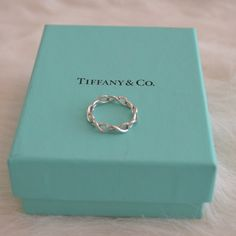 Tiffany Infinity Narrow Band Ring Delicate yet intricate in composition, this ring possesses a subtle elegance. Gently used but in excellent condition. Tiffany & Co. Jewelry Rings