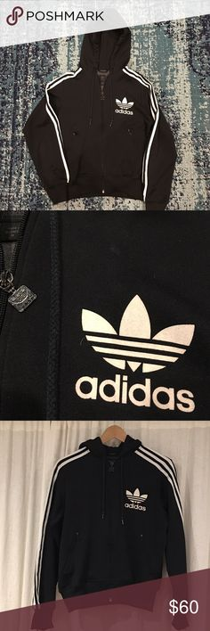 Vintage Adidas track jacket from the 90's Black hooded adidas track jacket from the mid-90's. Zipper closure pockets and from, 3 white stripes running along the sleeves. There is some minor wear on the jacket, which is shown in the last image: Small hole at bottom of jacket: minor pilling on lower section of jacket above right pocket: and a little wear on the zipper. Thanks for looking. Reasonable offers considered. Adidas Tops Sweatshirts & Hoodies