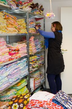 Junette at Pattern Like: Working girl - look at her shelves of amazing fabric!! *Swoon*