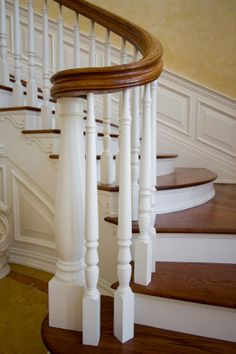Pretty traditional stairs with white balusters and mid-toned wood.