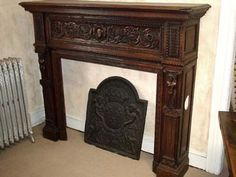 French, hand-carved wood fireplace mantel. Beautiful <3