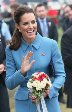BLENHEIM, NEW ZEALAND - APRIL 10: Catherine, Duchess of Cambridge smiles as she waves to crowds of public during a visit to Omaka Aviation Heritage Centre on Day 4 of a Royal Tour to New Zealand on April 10, 2014 in Blenheim, New Zealand. The Duke and Duchess of Cambridge are on a three-week tour of Australia and New Zealand, the first official trip overseas with their son, Prince George of Cambridge. (Photo by Chris Jackson/Getty Images)
