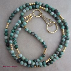 Ching hai jade and gold lanyard for your ID badge, keys, transportation pass and more.