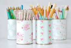 Pretty pen pots made with paper, double-sided tape, and tin cans. #DIY