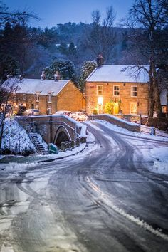 Pub and bridge over River Esk in village of Lealholm in North York Moors National Park, North Yorkshire, England