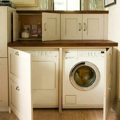 washer and dryer hidden behind panels in a laundry room