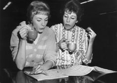circa 1965:  American actor and comedian Carol Burnett (right) and British singer and actor Julie Andrews (left) review the musical score for their television variety special 'Julie and Carol at Carnegie Hall' while holding cups of tea, New York City.  (Photo by Hulton Archive/Getty Images)