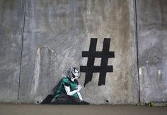 iHeart street art meets contemporary social media culture the young girl scribbles a huge hashtag onto the wall