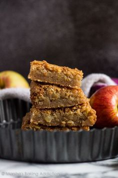 These cinnamon-spiced blondies are incredibly thick and chewy with a lovely crinkly top, and stuffed full of juicy apple chunks!