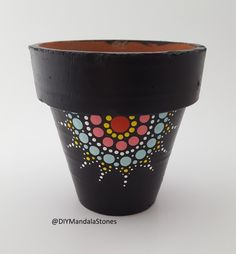 Simple mandala design on a potted plant. Made with the Mandala dotting tools. Buy at www.diymandalastones.com