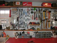 Get an inexpensive entertainment cabinet off craigslist and make this super dope pegboard wardrobe for tool organization.