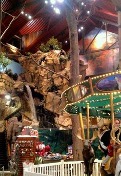 This is BassPro Shops Outdoor World, in Harrisburg, PA, USA. They have an indoor waterfall, a carousel, and the best stocked gun room in this state.