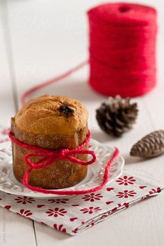 small panettone tied up by a red thread