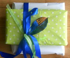 Gift packaging by Cecile Walters. Serviette, ribbon, painted leaf and tissue paper.