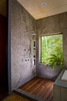 A Hemp Shower. Love the sharp corners on the window  and textured  hemp wall.