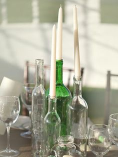 Recycled Bottle Centerpieces    Recycled glass bottles are a simple, inexpensive and eco-friendly way to add visual interest to your tables. Fill them with candles or wildflowers for an organic look.