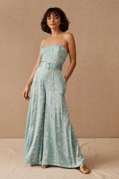A corseted bodice and wide legs give this floral jumpsuit a retro chic silhouette. A matching belt defines the waist, and the slender straps are detachable, offering two distinctive looks. Gala Dresses, Event Dresses, Floral Jumpsuit, Wrap Dress Floral, Black Tie Wedding Guest Dress, Bhldn, Dressed To Kill, 50 Fashion, Unique Dresses
