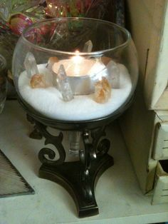 thedarkest-of-lights:  I put together this nice silver stand and got a wine glass and broke off the bottom and placed it in side the stand. I then proceeded to fill the cup with salt and made a crystal grid and a candle in the center.