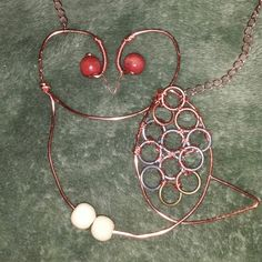 Copper owl pendant made with wire, wooden beads and various metal rings