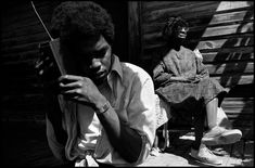Alex Webb  USA. Mississippi. Mound Bayou. 1976. Members of the community on their front porch.
