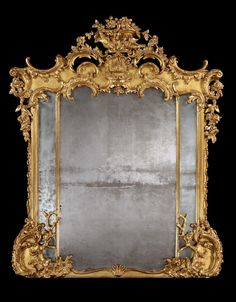 The mirror frame of serpentine symmetrical shape, being gilded; decorated with exuberant 'C' scrolls, naturalistic trees, foliates, and having two turtle doves atop; the triple mercury backed mirror plates divided by decorated vertical spacers. Circa 1870