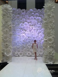 Balushka studios out of TX. She specializes in white and cream oversized paper flowers! Pretty cool. We love anyone who makes paper flowers