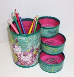Desk organizer made from tin cans. The cans were decoupaged, sealed, and glued together to form one unit. The floor of each can is lined with foam. by sherri