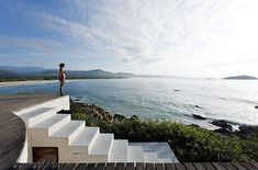 The Universe House, a beach house in Mexico barely higher than the rock it sits on, with a pool on the roof was designed by Mexican artist Gabriel Orozco and built by architect Tatiana Bilbao. Designed by Tatiana Bilbao one of the most promising newc Bilbao, A As Architecture, Journal Du Design, Architectural Photographers, Mexican Artists, Ways To Travel, Travel Tips, Travel Uk, Patio