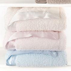Soft and fluffy like a cloud our brand new BellaTM is already attracting loyal fans. This cozy blanket features our BellaTM fabric on both sides and is trimmed in our signature satin picture frame border. One snuggle and you'll fall in love with Bella