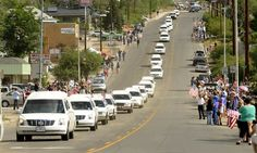 Coming home. Hearses carrying the bodies of 19 firefighters killed last week arrive in Prescott, Ariz., on Sunday during a procession that started in Phoenix.