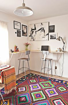 Standing desks are perfect for those who need to be on their computers constantly. Also, adding a fun rug creates a quirky office look!