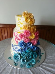 Gumpaste roses in brides colors. Very colorful bride!
