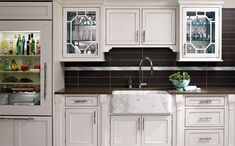 Austere cabinets, finished in Ivory give this kitchen a regal look.