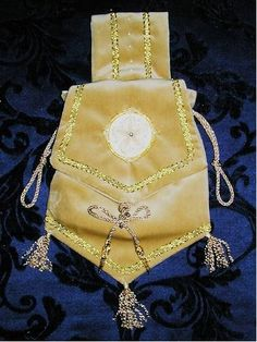 """The Pouch C. 1000 - 1533 From your belt you would hang your pouch or """"Aumoniére,"""" a very important accessory for both the man and woman in Medieval Times. There were no pockets, so money had to be carried in the pouch."""