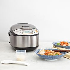 Set it and forget it! The Micom Rice Cooker & Warmer not only cooks flawless rice but also comes with a steaming basket to double as a steamer and a cake menu setting to bake cakes. From dinner to dessert, you've got it covered with this easily stored machine. Features: Micro computerized technology Doubles as a steamer with its versatile steam menu setting Easy-to-clean clear coated stainless steel exterior Automatic keep warm, extended keep warm and reheating cycle Interchangeabl...