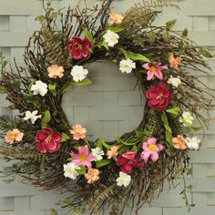 """Welcome spring and summer with this beautiful Blushing Pink Garden Wreath. Mixed with natural looking leaves, grasses and greenery on a natural twig vine, the wreath features beautiful silk flowers in shades of pink , rose and white, bringing a fresh, colorful spring touch to your decor. Use as a decorative indoor accent piece for any room to add vibrant charm. Measures 18"""" to 22"""" wide outer when fluffed out, with an 11"""" inner ring. #country #decor #artificial #spring #flowers #wreath"""