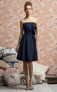 Not sure how I feel about the ruffle down the side--but otherwise love this dress and color-lp