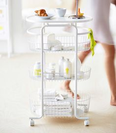 Sprutt collection at IKEA. A white trolley on castors filled with towels, shampoo bottles and toiletries.