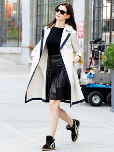 Anne Hathaway keeps it cool in shades as she struts her stuff on the set of her new comedy The Intern in New York City on Tuesday.