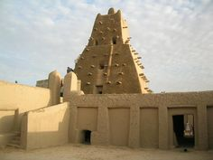 The Sankore Mosque, Timbuktu, Mali. The mosque, made from pounded earth and wood, was built in the late CE. Timbuktu Mali, Cob Building, Islam, Vernacular Architecture, Brick Architecture, Heritage Center, Africa Travel, World Heritage Sites, Traveling By Yourself
