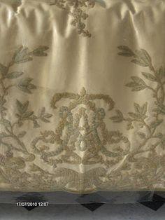 Monogram on a restored bedskirt in Marie Antoinette's apartment.