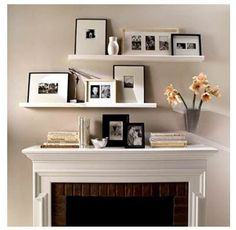 staggered shelves over mantel, these shelves can be found to purchase from IKEA in white, black or beech with matching, or accented, frames