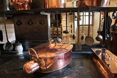 The gleam of copper in the Medieval kitchen at Chateau de Chenonceau, Loire Valley, France.